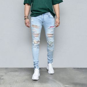 Multi Art Patch Damage Slim Taper-Jeans 552